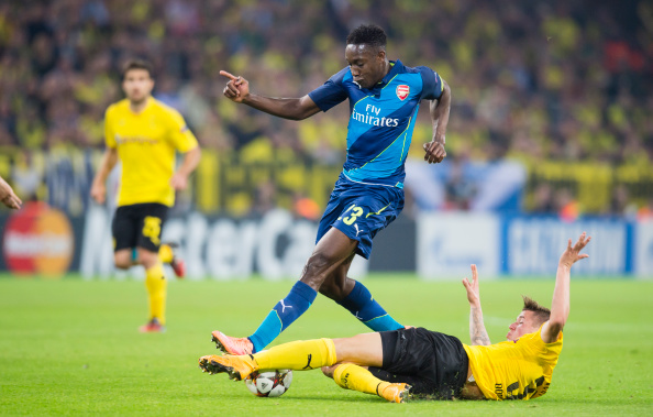 DORTMUND, GERMANY - SEPTEMBER 16:  Eric Durm of Borussia Dortmund in action against Arsenal's Danny Wellbeck during the UEFA Champions League first round between Borussia Dortmund and Arsenal FC at Signal Iduna Park on SEPTEMBER 16, 2014 in Dortmund, Germany.  (Photo by Alexandre Simoes/Borussia Dortmund/Getty Images)