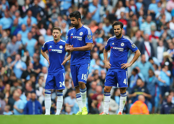 MANCHESTER, ENGLAND - AUGUST 16:  Cesc Fabregas (R) and Diego Costa of Chelsea look dejected after the third Manchester City goal scored by Fernandinho of Manchester City during the Barclays Premier League match between Manchester City and Chelsea at the Etihad Stadium on August 16, 2015 in Manchester, England.  (Photo by Alex Livesey/Getty Images)