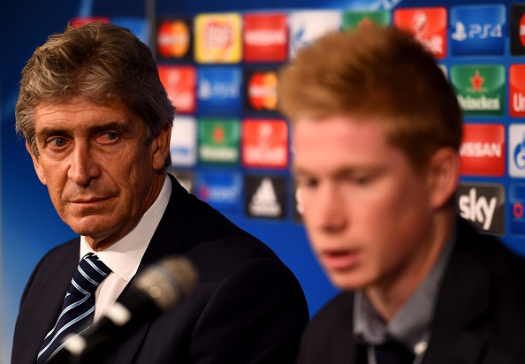 MOENCHENGLADBACH, GERMANY - SEPTEMBER 29:  Head coach Manuel Pellegrini is seen next to Kevin de Bruyne during a Manchester City press conference on the eve of the UEFA Champions League groupe D match against Borussia Moenchengladbach at Borussia-Park on September 29, 2015 in Moenchengladbach, Germany.  (Photo by Lars Baron/Bongarts/Getty Images)