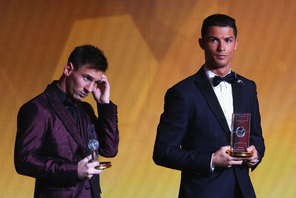 ZURICH, SWITZERLAND - JANUARY 12:  FIFA Ballon d'Or nominee Lionel Messi (L) of Argentina and Barcelona stands with fellow nominee Cristiano Ronaldo of Portugal and Real Madrid as they are selected for the FIFA/FIFPro World XI for 2014 during the FIFA Ballon d'Or Gala 2014 at the Kongresshaus on January 12, 2015 in Zurich, Switzerland.  (Photo by Alexander Hassenstein - FIFA/FIFA via Getty Images)