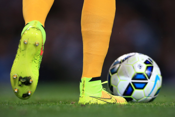 MANCHESTER, ENGLAND - AUGUST 25: Man City goalkeeper Joe Hart wearing yellow Nike Magista boots during the Barclays Premier League match between Manchester City and Liverpool at the Etihad Stadium on August 25, 2014 in Manchester, England. (Photo by Simon Stacpoole/Mark Leech Sports Photography/Getty Images)