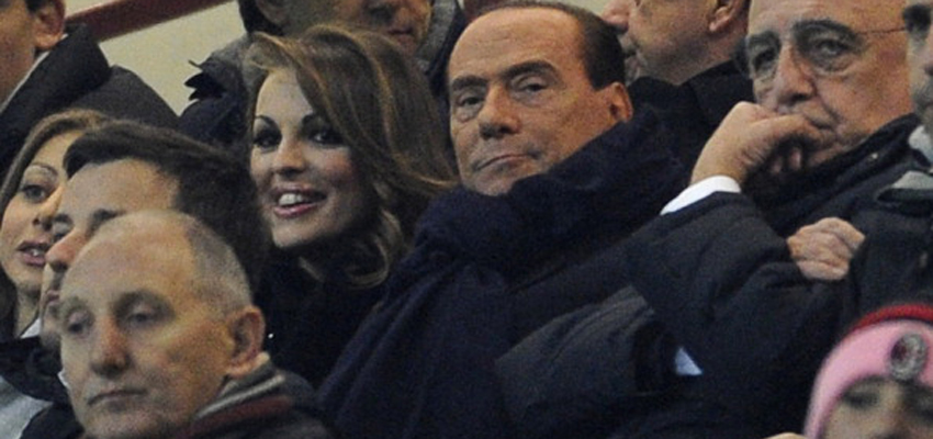 MILAN, ITALY - DECEMBER 04:  Silvio Berlusconi and Francesca Pascale (L) attend the UEFA Champions League group C match between AC Milan and Zenit St Petersburg at San Siro Stadium on December 4, 2012 in Milan, Italy.  (Photo by Claudio Villa/Getty Images)