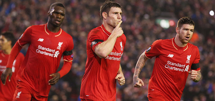 LIVERPOOL, ENGLAND - NOVEMBER 26:  James Milner of Liverpool (C) celebrates as he scores their first and equalising goal from the penalty spot with Christian Benteke (L) and Alberto Moreno (R) during the UEFA Europa League Group B match between Liverpool FC and FC Girondins de Bordeaux at Anfield on November 26, 2015 in Liverpool, United Kingdom.  (Photo by Alex Livesey/Getty Images)
