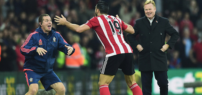 SOUTHAMPTON, ENGLAND - NOVEMBER 01:  Graziano Pelle of Southampton performs a haka style celebration with Southampton sports therapist Graeme Staddon as he scores their second goal as Ronald Koeman manager of Southampton looks on during the Barclays Premier League match between Southampton and A.F.C. Bournemouth at St Mary's Stadium on November 1, 2015 in Southampton, England.  (Photo by Alex Broadway/Getty Images)
