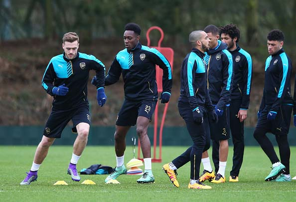 ST ALBANS, ENGLAND - FEBRUARY 22: Calum Chambers (L) and Danny Welbeck warm up with team mates during the Arsenal training session ahead of the UEFA Champions League match against Barcelona at London Colney on February 22, 2016 in St Albans, United Kingdom.  (Photo by Matthew Lewis/Getty Images)